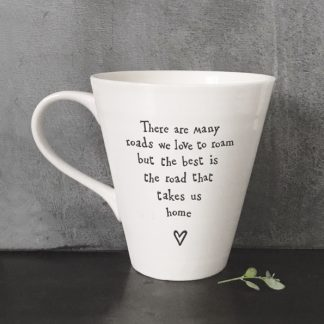 image of white mug with road to home quote