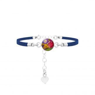image of silver fashion bracelet with blue strap and round centre with real mixed flowers