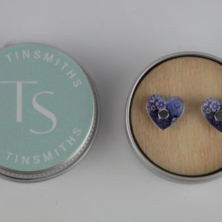 image of The Tinsmiths Forget-me-not Heart stud earrings in a tin