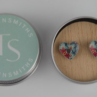 image of The Tinsmiths Tiger Lily Heart stud earrings in a tin