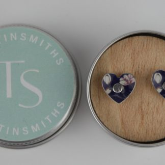 image of The Tinsmiths Jasmine Heart stud earrings in a tin