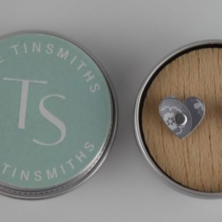 image of The Tinsmiths Scandi grey Heart stud earrings in a tin