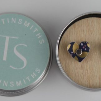 image of The Tinsmiths Kyoto Blue Heart stud earrings in a tin