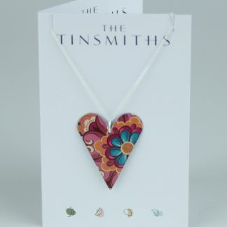 image of The Tinsmiths Tiger Lily Medium Heart Pendant made from recycled tin