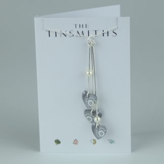 image of The Tinsmiths Scandi Grey Three Hearts Necklace