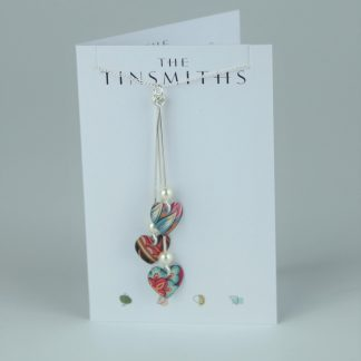 image of The Tinsmiths Tiger Lily Three Hearts Necklace