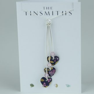 image of The Tinsmiths Kyoto Blue Three Hearts Necklace
